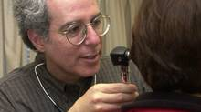 Dr. Rick Glazier examines a patient. (Fred Lum/The Globe and Mail)
