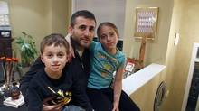 Five-year-old Benjamin, nine-year-old Ysabel and father Corby Fine at their home in Toronto. (Fernando Morales/The Globe and Mail)
