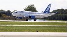 Bombardier's CSeries aircraft lands after its first test flight in Mirabel, Quebec September 16, 2013. (CHRISTINNE MUSCHI/REUTERS)