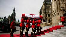 RCMP pallbearers carry the casket of NDP leader Jack Layton into Parliament Hill in Ottawa on Aug. 24, 2011. (Dave Chan For The Globe and Mail)