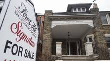 A realtor's sign is placed on the front yard of a home for sale in Toronto in this file photo. (Fred Lum/The Globe and Mail)