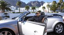 Man in convertible, living the rich wealthy high life. (Photos.com)