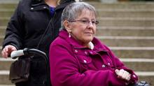 Gloria Taylor arrives at British Columbia Supreme Court in Vancouver, B.C., in this December 1, 2011 file photo. A B.C. Supreme Court judge has struck down the laws banning doctor-assisted suicide, calling the them discriminatory, disproportionate and overbroad. (Darryl Dyck/The Canadian Press)