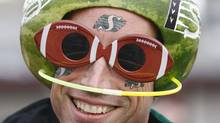 A Saskatchewan Roughriders fan wears the traditional watermelon helmet as he arrives for the 97th Grey Cup game in Calgary, Sunday November 29, 2009. THE CANADIAN PRESS/Nathan Denette (Nathan Denette/CP)