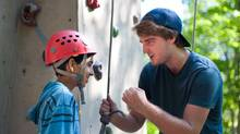 Instructor John McCracken helps a child at Camp Arowhon in Ontario. (Leon Muszynski)