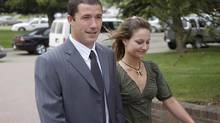 Shawn Hennessey and his wife Christine arrive at the courthouse in Stony Plain, Alberta to hear whether the judge would allow his trial to go ahead on Friday June 6, 2008. Mr. Hennessey and his brother-in-law, Dennis Cheeseman, pleaded guilty to manslaughter for giving James Roszko a rifle and a ride to Mr. Roszko's farm near Mayerthorpe in 2005. Mr. Roszko ambushed and killed the officers before he was shot and wounded, then killed himself. (Ian Jackson/THE CANADIAN PRESS)