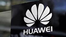 A Huawei logo is seen above the company's exhibition pavilion during the CommunicAsia information and communications technology trade show in Singapore in this June 19, 2012 file photograph. Huawei is the world's biggest telecommunications-equipment manufacturer. (TIM CHONG/REUTERS)