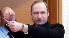 This is a Monday, Feb. 6, 2012 file photo of Anders Behring Breivik, a right-wing extremist who confessed to a bombing and mass shooting that killed 77 people on July 22, 2011, as arrives for a detention hearing at a court in Oslo, Norway. (Heiko Junge, Scanpix Norway/AP)