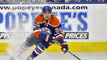 Edmonton Oilers' Nail Yakupov looks to pass the puck during the third period of their NHL game against the Los Angeles Kings in Edmonton January 24, 2013. (DAN RIEDLHUBER/REUTERS)