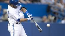Toronto Blue Jays' Edwin Encarnacion hits a two run homer against the New York Yankees during second inning AL action in Toronto on Wednesday August 28, 2013. (Frank Gunn/THE CANADIAN PRESS)