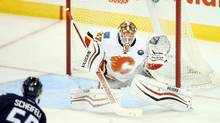 Having a strong preseason in the Flames crease, rookie Joni Ortio is the team's youngest goalie by far and at $600,000 a season, he is also the cheapest by a long shot. (Bruce Fedyck/USA Today Sports)