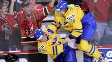Sweden's Mika Zibanejad, right, celebrates with teammate Petter Granberg after scoring the winning goal against Russia in overtime  during the gold medal game of the 2012 IIHF U20 World Junior Hockey Championships in Calgary, Alberta, January 5, 2012.  (Reuters)