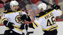 Boston Bruins defenseman Andrew Ference (21) celebrates his goal with David Krejci (46), during the third period of Game 6. (Nick Wass/Associated Press)