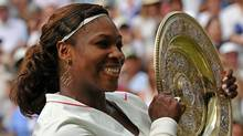 Serena Williams of US holds the Wimbledon Trophy after defeating Vera Zvonareva of Russia 6-3, 6-2, in the Women's Final at the Wimbledon Tennis Championships at the All England Tennis Club, in south-west London, on July 3, 2010. (ADRIAN DENNIS)