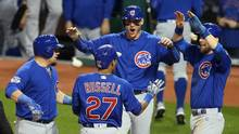 Cubs shortstop Addison Russell celebrates with teammates after hitting a grand slam in Game 6. (Charles LeClaire/USA Today Sports)