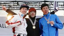 Gold medallist Qi Guangpu (C) of China, silver medallist Travis Gerrits (L) of Canada and bronze medallist Jia Zongyang of China display their medals on the podium after the Men's Aerials race at the FIS Freestyle World Ski Championships in Voss March 7, 2013. (NTB SCANPIX/REUTERS)