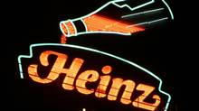 A giant neon sign adorns the top of the H.J. Heinz Co. headquarters in Pittsburgh in this file photo. (GENE J. PUSKAR/AP)
