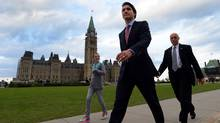 Prime minister designate Justin Trudeau makes his way from Parliament Hill to the National Press Theatre to hold a press conference in Ottawa on Tuesday, October 20, 2015. (SEAN KILPATRICK/THE CANADIAN PRESS)