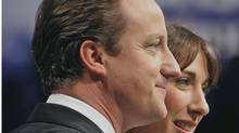 David Cameron with his wife Samantha (Kirsty Wigglesworth/AP)