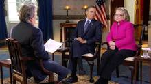 In this Jan. 25, 2013 file image taken from video and provided by CBS, President Barack Obama, center, and Secretary of State Hillary Rodham Clinton speak with 60 Minutes correspondent Steve Kroft, left, in the Blue Room of the White House in Washington. (Uncredited/AP)