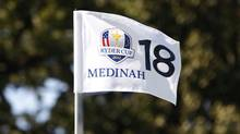 The flag stick sits in the hole on the 18th green as preparations continue for the 39th Ryder Cup golf matches at the Medinah Country Club in Medinah, Illinois, September 24, 2012. (MATT SULLIVAN/REUTERS)