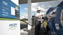 An employee filling up his natural gas truck at Encana's new compressed natural gas (CNG) fueling station in Louisianas Red River Parish, which was opened on November 30, 2010. (Encana)