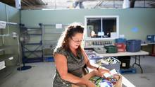 Angela Graham works on an hourly basis at a telemarketing firm. Because of her low wages, she has been dropping by the Daily Bread Food Bank in Etobicoke to help stretch her food dollars. (Fred Lum/The Globe and Mail)