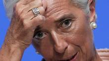 IMF managing director Christine Lagarde gestures during her speech at a forum for the annual meetings of the IMF and World Bank Group at a Tokyo hotel Friday, July 6, 2012. (Itsuo Inouye/AP)
