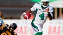 Saskatchewan Roughriders' quarterback Darian Durant runs the ball against the Hamilton Tiger-Cats during first half CFL action at Ivor Wynne Stadium in Hamilton, Ont., Friday, June 29, 2012. (Geoff Robins/THE CANADIAN PRESS)