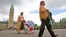 Miriam Llorete, a Mexican tourist, pushes her daughter as she follows her mother during a visit to Parliament Hill on July 14, 2009. (Sean Kilpatrick/The Canadian Press)