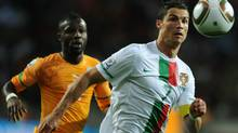 Portugal's striker Cristiano Ronaldo runs for the ball during the Group G first round 2010 World Cup football match Ivory Coast vs. Portugal. (FRANCISCO LEONG/AFP/Getty Images)