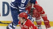 Toronto Maple Leafs right wing Joffrey Lupul (19) cross checks Detroit Red Wings forward Patrick Eaves during the first period of the Winter Classic outdoor NHL hockey game at Michigan Stadium in Ann Arbor, Mich., Wednesday, Jan. 1, 2014. (Carlos Osorio/AP)