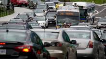 Motorists merge from four lanes into one as they enter the Lions Gate Bridge to drive into Vancouver, B.C. (DARRYL DYCK/THE CANADIAN PRESS)