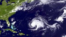 Hurricane Leslie (C) and Hurricane Michael (R) are seen in this NOAA handout satellite image taken September 6, 2012. (HANDOUT/Reuters)