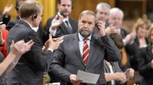 NDP Leader Thomas Mulcair receives applause after asking a question during Question Period in the House of Commons on Parliament Hill in Ottawa, Tuesday, Sept.23, 2014. (Adrian Wyld/THE CANADIAN PRESS)