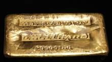 A 999.9 fine gold 100 troy ounce Engelhard gold bar. (SHANNON STAPLETON/REUTERS)
