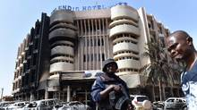 A policeman stands guard in front of the Splendid hotel, on January 17, 2016 in Ouagadougou, following a jihadist attack by al-Qaeda linked gunmen late on January 15. (ISSOUF SANOGO/AFP/Getty Images)