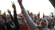 Women shout during a protest in Tahrir Square in Cairo January 25, 2013. (MOHAMED ABD EL GHANY/REUTERS)