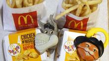 Two McDonald's Happy Meal with toy watches fashioned after the characters Donkey and Puss in Boots from the movie Shrek Forever After are pictured in Los Angeles June 22, 2010. (MARIO ANZUONI/REUTERS)