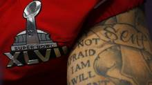 The left arm of San Francisco 49ers quarterback Colin Kaepernick is shown with his tattoos during Media Day for the NFL's Super Bowl XLVII in New Orleans, Louisiana, January 29, 2013. The 49ers will meet the Baltimore Ravens in the game on February 3. (JEFF HAYNES/REUTERS)
