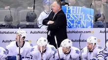 Toronto Maple Leafs head coach Randy Carlyle watches game action in the first period against the Colorado Avalanche at the Pepsi Center. (Ron Chenoy/USA Today Sports)