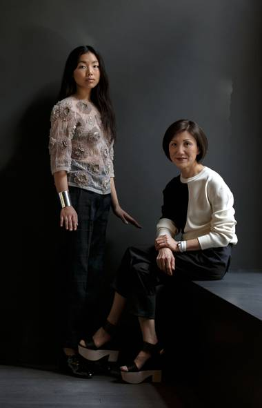 Mi Kyum Kim, right, chef-owner of the popular Korean restaurant Omma, and her daughter, artist Jessica Wee, take a breather while perusing the latest designer wares at Cahier d'Exercices, a boutique in Old Montreal. On Jessica: Dries Van Noten top, pants and cuff, $1,595, $640 and $695. Balenciaga shoes, $975. On Mi Kyum: Céline sweater, bracelet and shoes, $1,200, $395 and $1,150. Comme des Garçons pants, $360. All clothing at Cahier d'Exercices (www.cahierdexercices.com). (Alexi Hobbs for The Globe and Mail)
