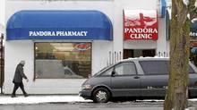 A man walks past Pandora Pharmacy in Victoria, British Columbia on Nov. 25, 2010. (Deddeda Stemler for the Globe and Mail/Deddeda Stemler for the Globe and Mail)