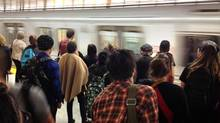 Commuters wait to board a westbound subway at the Keele St. subway station on Sept 30 2014. TTC commuters travelling on the Bloor-Danforth subway line had to stake shuttle buses when service between Keele St. and St. George was interrupted. The east end closure was moved to Ossington station shortly. Buses shuttled passengers between the two ends. (Fred Lum/The Globe and Mail)