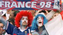 French supporters wave a France 98 scarf in celebration during the group C soccer World Cup 98 match between France and Saudi Arabia at the Stade de France in St Denis, north of Paris Thursday June 18, 1998. (Michel Lipchitz/AP)