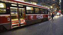 Commuters board an eastbound King St. streetcar at Yonge St. on Dec 8 2014. (Fred Lum/The Globe and Mail)