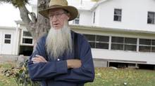 In this Oct. 10, 2011 file photo, Sam Mullet stands in front of his Bergholz, Ohio, home. Beard- and hair-cutting attacks were in apparent retaliation against Amish who had defied or denounced Mullet's authoritarian style. (Amy Sancetta/Associated Press)