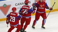 Russia's Nail Yakupov (R) celebrates his goal with Mikhail Grigorenko (C) and Pavel Koledov during the first period of their preliminary round game against Germany during the 2013 IIHF U20 World Junior Hockey Championship in Ufa, December 29, 2012. (MARK BLINCH/REUTERS)