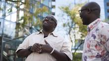 John Githongo, left, a former Kenyan journalist who investigated bribery and fraud in his home country, and Rafael Marques de Morais, right, an Angolan journalist and human rights activist, meet for the first time in Vancouver on Wednesday. (Rafal Gerszak for The Globe and Mail)