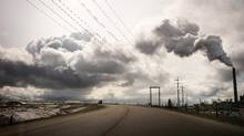 Highway 63 curves past the Syncrude oil sands site, north of Fort McMurray, Alberta, May 6th, 2015. (Ian Willms For The Globe and Mail)